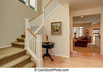 Nice entryway to home with staircase.