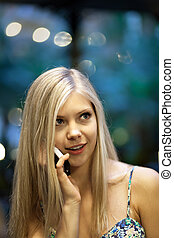 Blonde Woman on Cell Phone - Smiling attractive blonde woman...