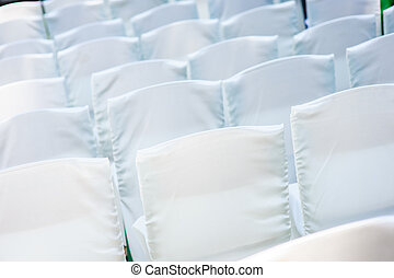 White wedding chairs for the ceremony