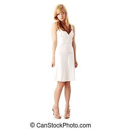 Blond teen girl in white dress