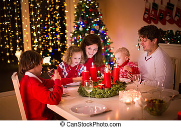 Family with children at Christmas dinner - Big family with...