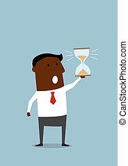 Black businessman with hourglass in hand - Black businessman...