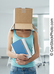 Think outside the box - Young student standing with a box on...