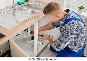 Plumber Fixing Sink Pipe - Male Plumber Fixing Sink Pipe...