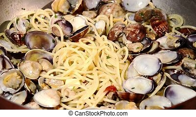 seafood, clams - cooking spaghetti with clams