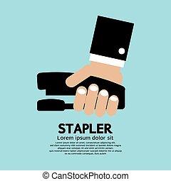 Hand Holding A Stapler.