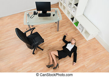 Businesswoman Fainted In Office - High Angle View Of Young...