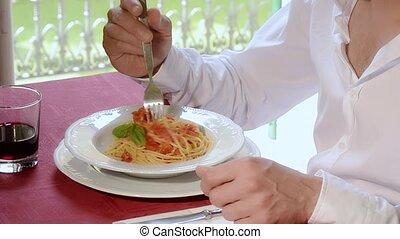 italian food, spaghetti with pomato - a man eating spaghetti...