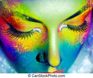 Close up portrait of beautiful fashion woman with color art...
