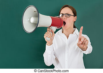 Businesswoman Shouting Though Megaphone - Young...