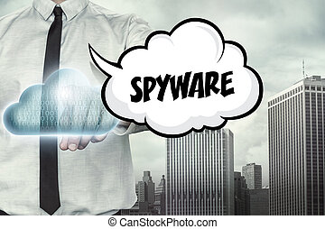 Spyware text on cloud computing theme with businessman on...