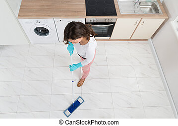 Woman Mopping Floor - High Angle View Of Woman Mopping Floor...