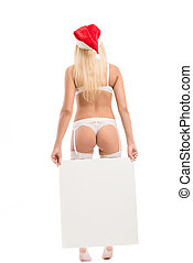 Sexy santa girl holding blank board, isolated on white