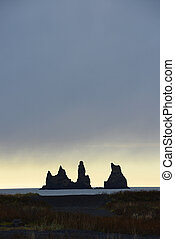 vik sea stack - sea stack troll rock at vik in iceland