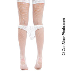 Beautiful female legs in white fishnet stockings with panties