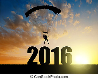 Landing in the New Year 2016 - Silhouette skydiver...