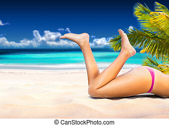 Woman is lying on the beach - Woman is lying on the tropical...