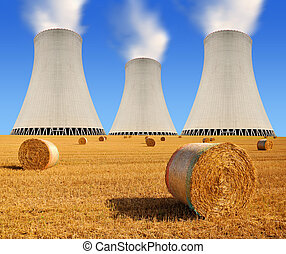 nuclear power plant - Bales of straw on the field and...