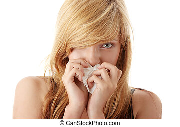 Young blonde woman having a cold
