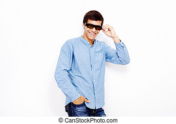 Guy with 3D TV glasses - Young hispanic man wearing jeans...