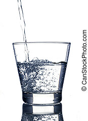 Water is poured into a glass on white background