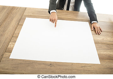 Businessman pointing to a blank placard - Businessman...
