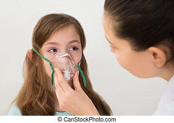 Doctor Holding Inhaler Mask For Girl Breathing - Medical...