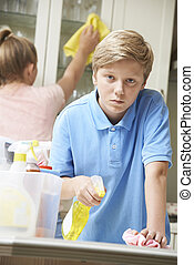 Unhappy Children Helping to Clean House
