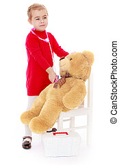 Little girl Teddy bear treats - Cute little blonde girl in a...