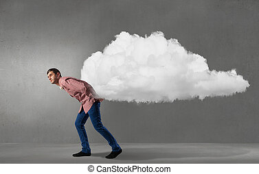 Man lifting cloud - Young man in casual carrying cloud on...