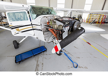 Repairing small propeller airplane