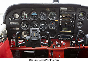 Contol panel on an airplane - Flight desk control panel on a...