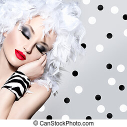 Beauty fashion model girl with white feathers hairstyle