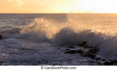 Waves splashing against morning sun - Bright yellow orange...