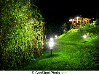 Wooden arbour at night - Wooden arbour and green osier at...