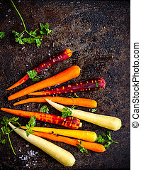 rainbow carrot - raw rainbow carrot for roasting, on a...