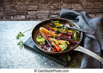 roasted vegetables in pan - roasted rainbow carrot and...