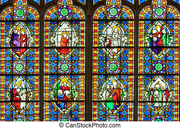 colorful stained glass window with saints.