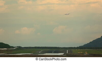 Final approach - Airplane makes landing along the runway in...