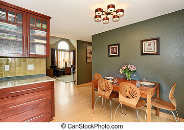 Simple dinning area with connected kitchen.