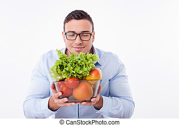 Handsome young fit man prefers healthy eating - Cheerful man...