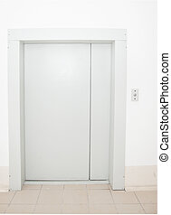 Front view of a modern elevator with closed doors