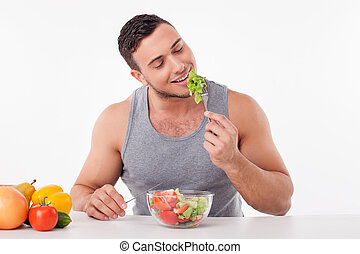 Attractive young fit guy prefers healthy eating - Handsome...