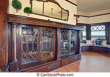 Nice hallway with decorative glass case. - Nice hallway with...