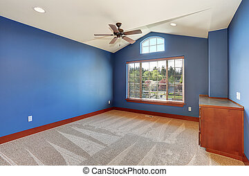 Large unfurnished room with blue interior. - Large...