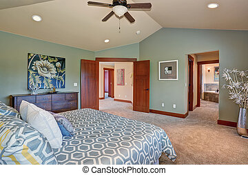 Large bedroom with green interior.