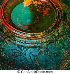 View from above on ancient colorful textured  vase