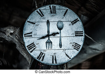 Numbered dial plate with fork and spoon on mystery dark...