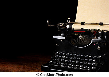 Old vintage typewriter with blank paper