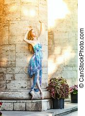 Ballerina dancing at sunset